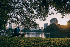 a couple sitting by the lake