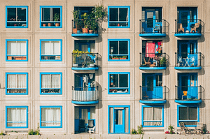 an apartment building with many windows